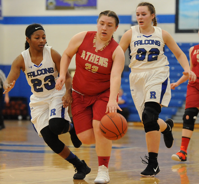 Troy Athens' CeCe Resendez (22) brings the ball up court past Rochester's Tori Hawkins (23) and Alyssa Miller (32) during the OAA White match up played on Thursday Feb. 22, 2018 at Rochester High School.  Resendez had a game high 10 points to help lead the Red Hawks to a 35-28 win .  (Oakland Press photo by Ken Swart)