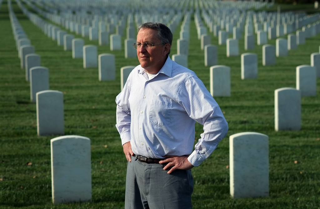 . Researcher William Beigel looks through the thousands of gravestones at the Los Angeles National Cemetery Tuesday. Beigel researches and documents UCLA alumni who were killed in WWII. 20130326 Photo by Steve McCrank / Staff Photographer