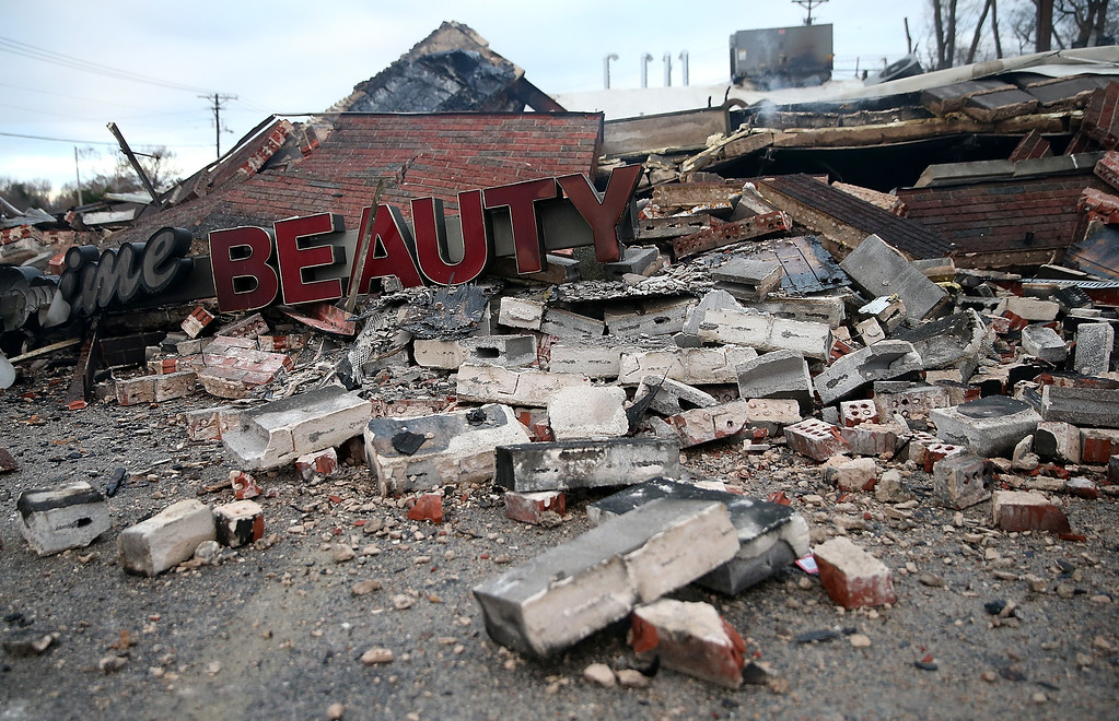 . A sign sits amidst rubble at a building that was damaged during a demonstration on November 25, 2014 in Dellwood, Missouri. Demonstrators caused extensive damage in Ferguson and surrounding areas last night after a St. Louis County grand jury decided to not indict Ferguson police Officer Darren Wilson in the shooting of Michael Brown.  (Photo by Justin Sullivan/Getty Images)