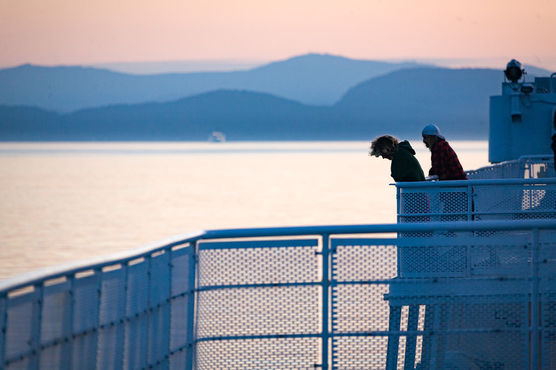 Tourists look out over the waters during a British ferry crossing - , Capital, British Columbia, Canada (CA)