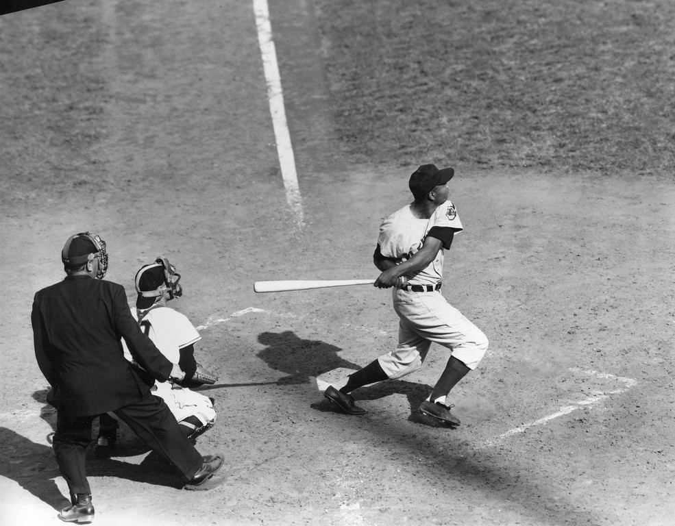 . Cleveland Indians center fielder Larry Doby swings and drives a single to right field in the 5th inning of World Series game opener at the Polo Grounds in New York, Sept. 29, 1954.  New York Giants catcher is Wes Westrum.  Umpire is Al Barlick.  The Giants won 5-2.  (AP Photo)
