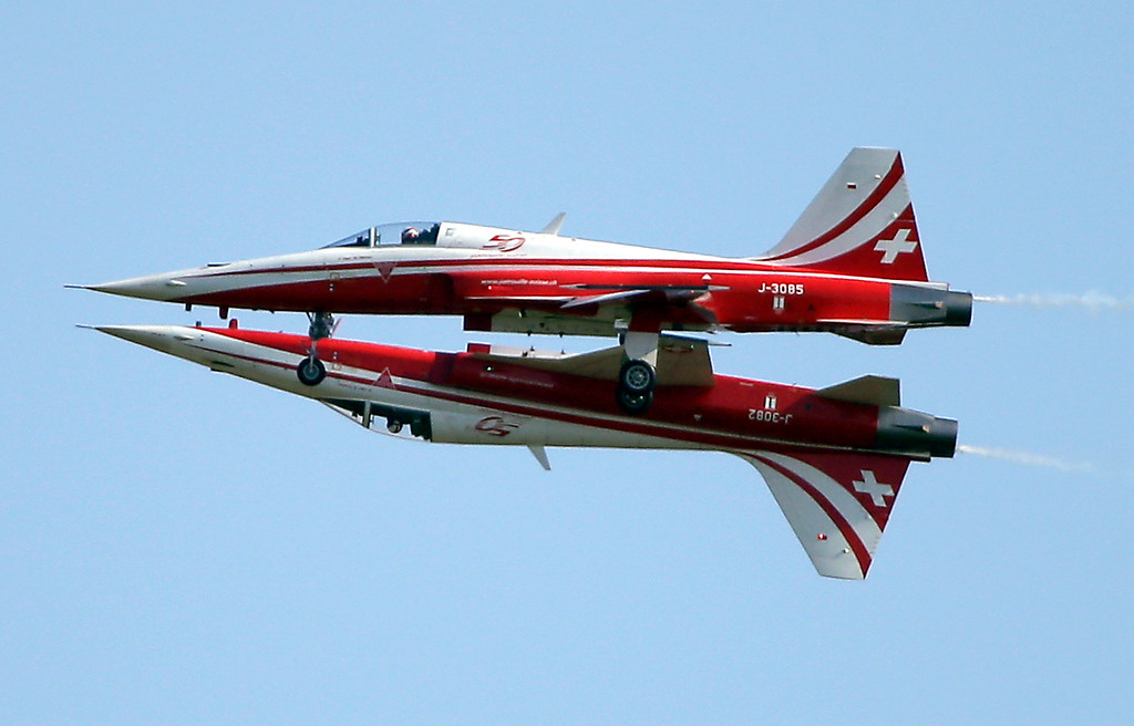 . Two Northrop F-5E Tiger II airplanes of the Swiss Patrol fly close together during an aerobatic performance   at the ILA Berlin Air Show in Berlin, Germany, Tuesday, May 20, 2014. The Berlin Air Show takes place from May 20 until May 25, 2014 .  (AP Photo/Michael Sohn)