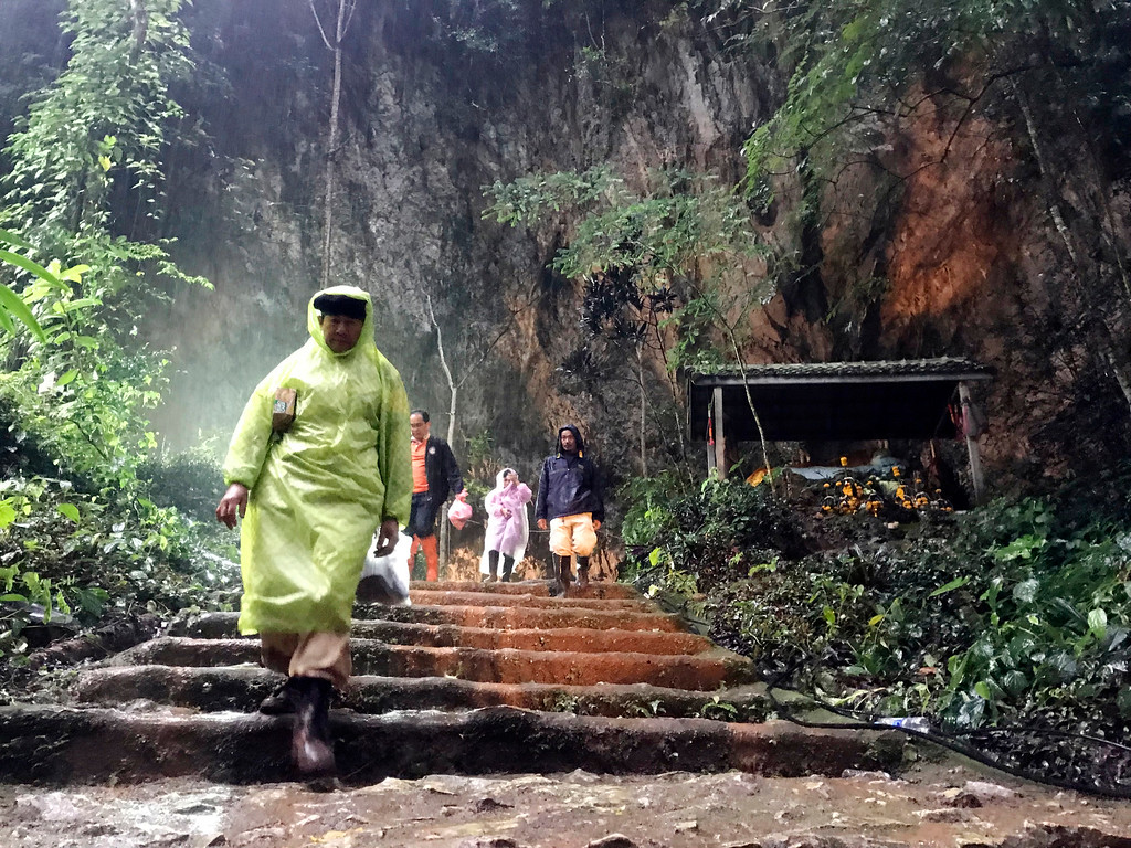 . Rescue workers walk out from a cave in Mae Sai, Chiang Rai province, northern Thailand, Wednesday, June 27, 2018. Heavy rains are hampering efforts to rescue the 12 boys and their soccer coach who have been missing inside the flooded cave in northern Thailand for four days. (AP Photo/Tassanee Vejpongsa)
