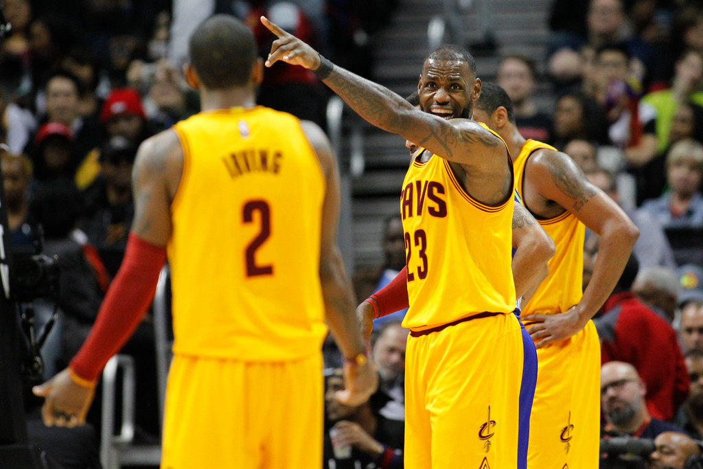 . Cleveland Cavaliers forward LeBron James (23) talks to guard Kyrie Irving (2) against the Atlanta Hawks in the second half of an NBA basketball game, Friday, March 3, 2017, in Atlanta. The Cavaliers won 135-130. (AP Photo/Brett Davis)
