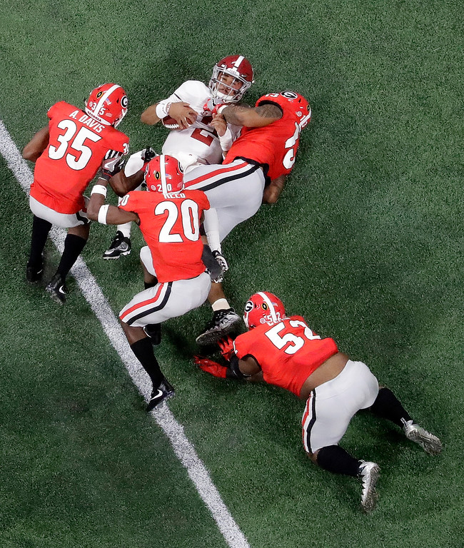. Alabama quarterback Jalen Hurts is sacked during the first half of the NCAA college football playoff championship game against Georgia Monday, Jan. 8, 2018, in Atlanta. (AP Photo/John Bazemore)