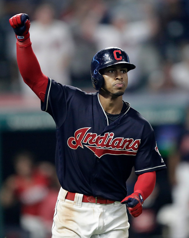 . Cleveland Indians\' Francisco Lindor watches after hitting a game-winning three run home run in the ninth inning of a baseball game against the Minnesota Twins, Wednesday, Aug. 8, 2018, in Cleveland. (AP Photo/Tony Dejak)