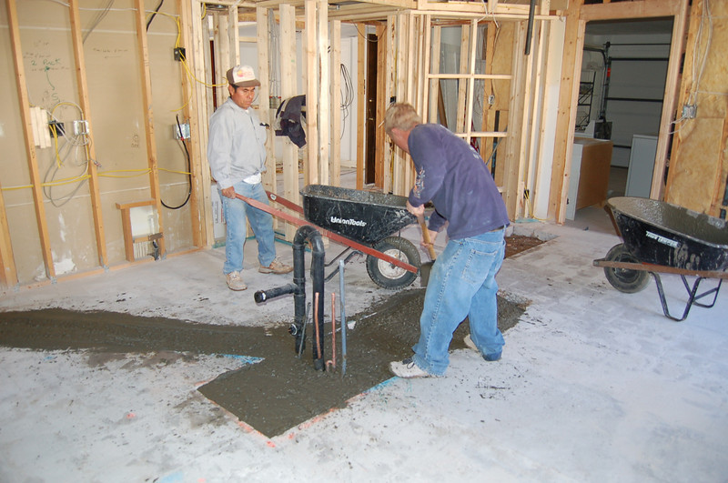 The kitchen concrete being repaired.