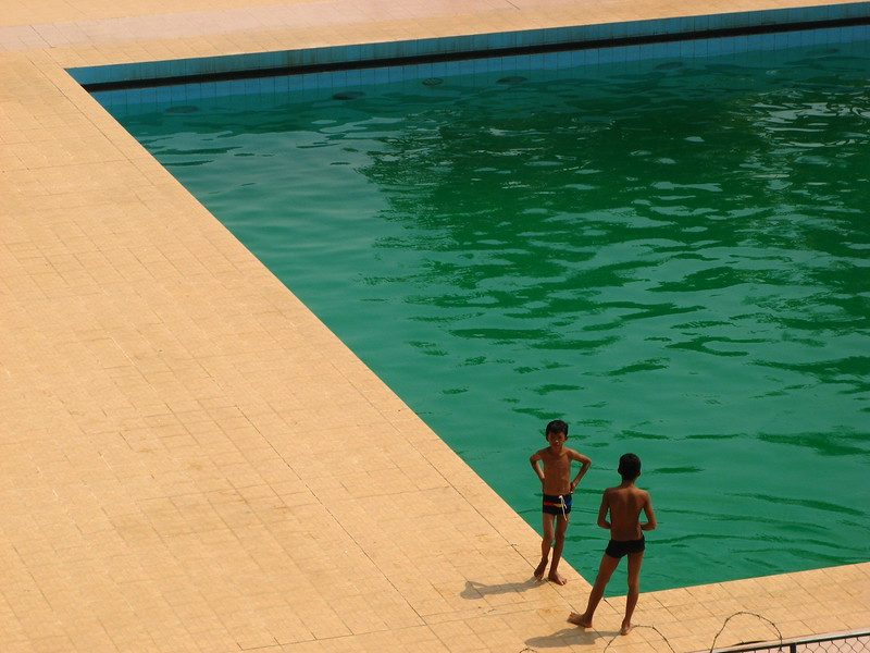 A couple kids that snuck into the pool at the Olympic Stadium complex.
