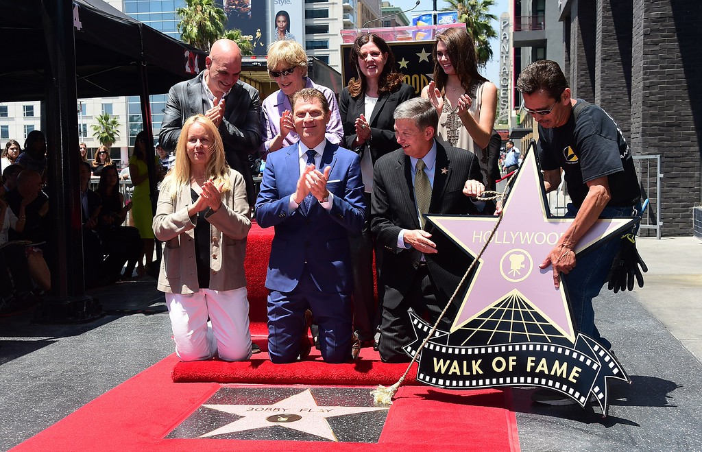 . Chef Bobby Flay(C) reacts as his star is unveiled on the Hollywood Walk of Fame on June 2, 2015, in Hollywood, California. Flay is the first television chef to be accorded the honor.       (FREDERIC J. BROWN/AFP/Getty Images)