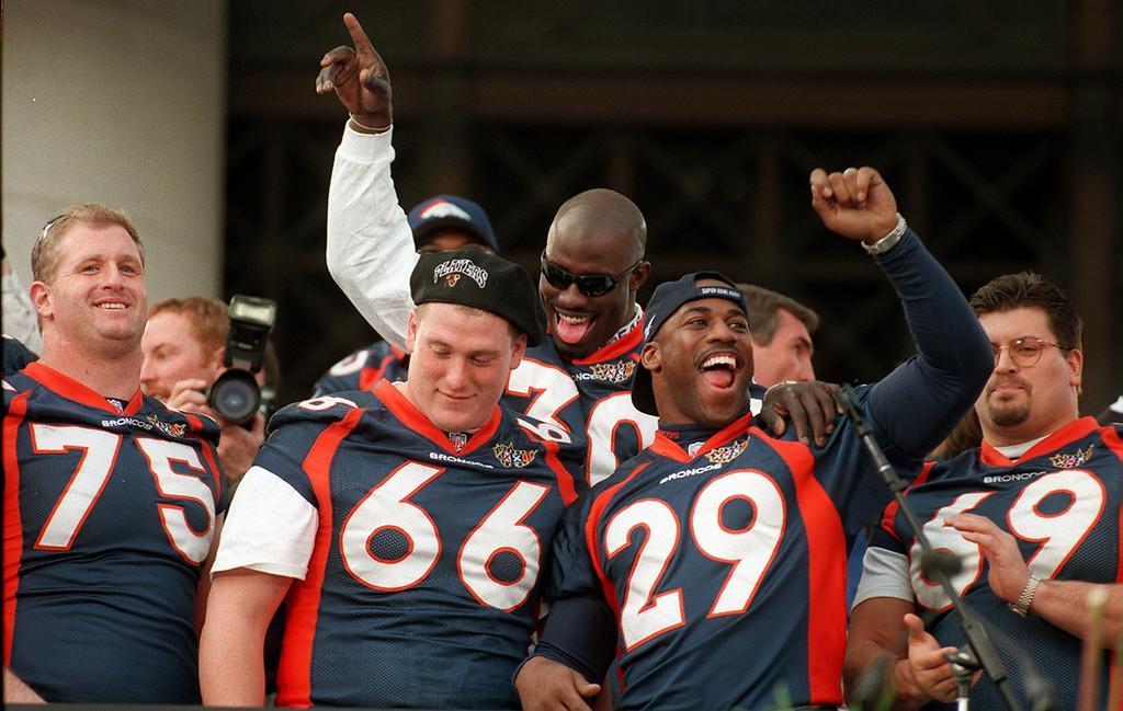 . Caption: Broncos Terrell Davis jokes around with #75 Brian Habib,  #66 Tom Nalen, #29 Howard Griffith, during rally at the City &  County Building ain Denver.  Photographer: John Leyba/ The Denver Post