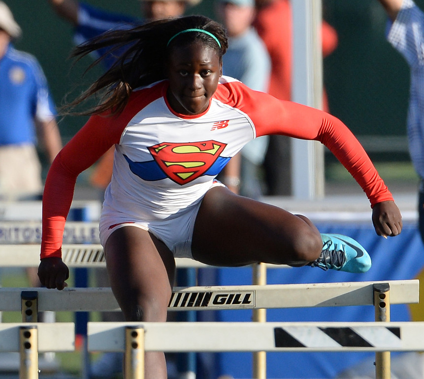 . Serra\'s Jeanette Paul competes in the 100 meter hurdles during the CIF-SS Masters Track and Field meet at Falcon Field on the campus of Cerritos College in Norwalk, Calif., on Friday, May 30, 2014.   (Keith Birmingham/Pasadena Star-News)