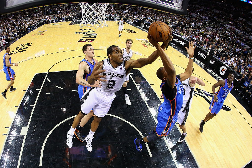 . Kawhi Leonard #2 of the San Antonio Spurs goes for a rebound against Caron Butler #2 of the Oklahoma City Thunder in the second half during Game Five of the Western Conference Finals of the 2014 NBA Playoffs at AT&T Center on May 29, 2014 in San Antonio, Texas.  (Photo by Ronald Martinez/Getty Images)