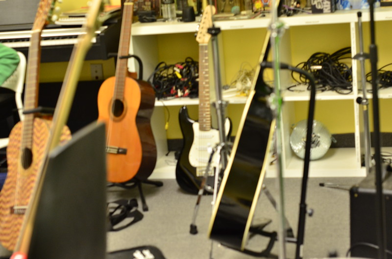 Guitars resting in the music room.