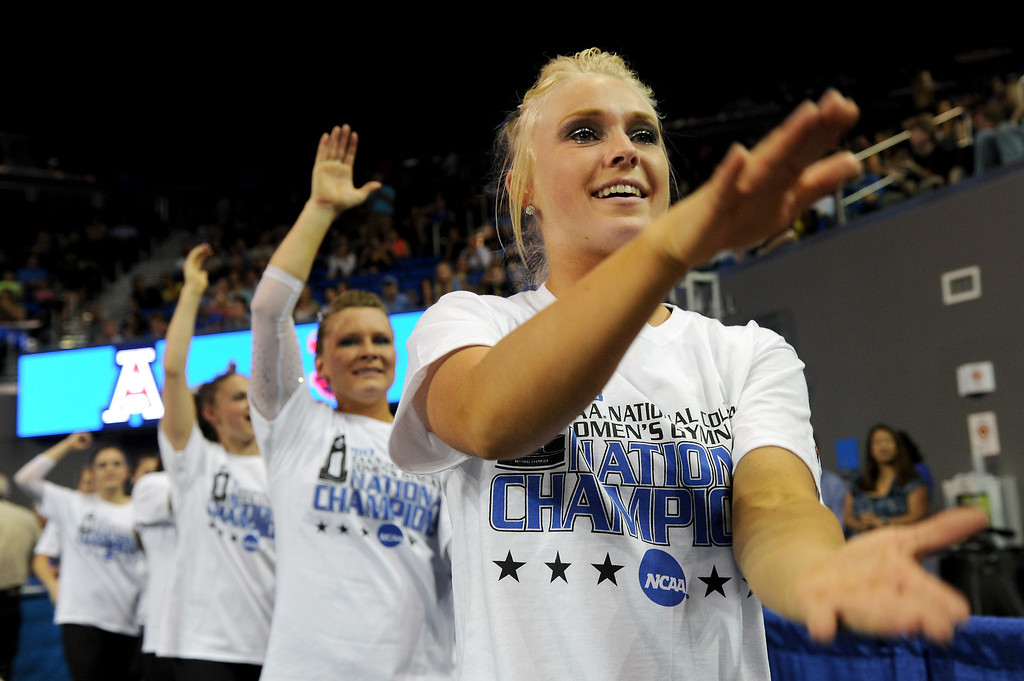 ". The Florida gymnastics team does the ""gator chomp\"" after winning the NCAA Women\'s Gymnastics Championship Team Finals at Pauley Pavilion, Saturday, April 20, 2013. (Michael Owen Baker/Staff Photographer)"