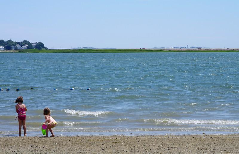 Sky, land, water, sand.
