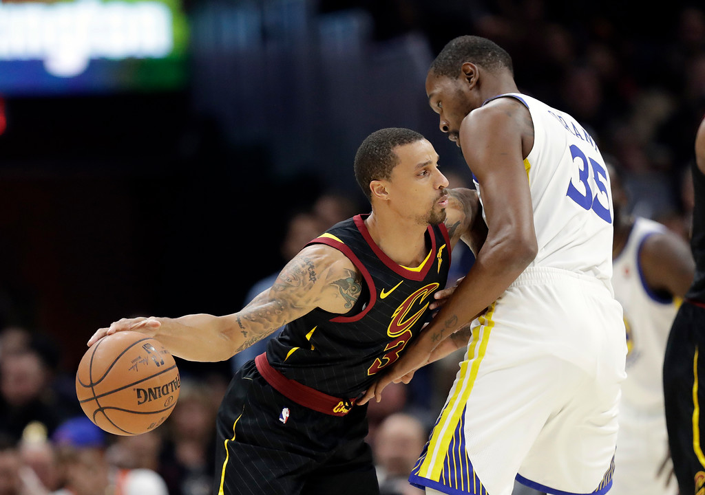 . Cleveland Cavaliers\' George Hill goes to the basket as Golden State Warriors\' Kevin Durant defends during the first half of Game 3 of basketball\'s NBA Finals, Wednesday, June 6, 2018, in Cleveland. (AP Photo/Tony Dejak)