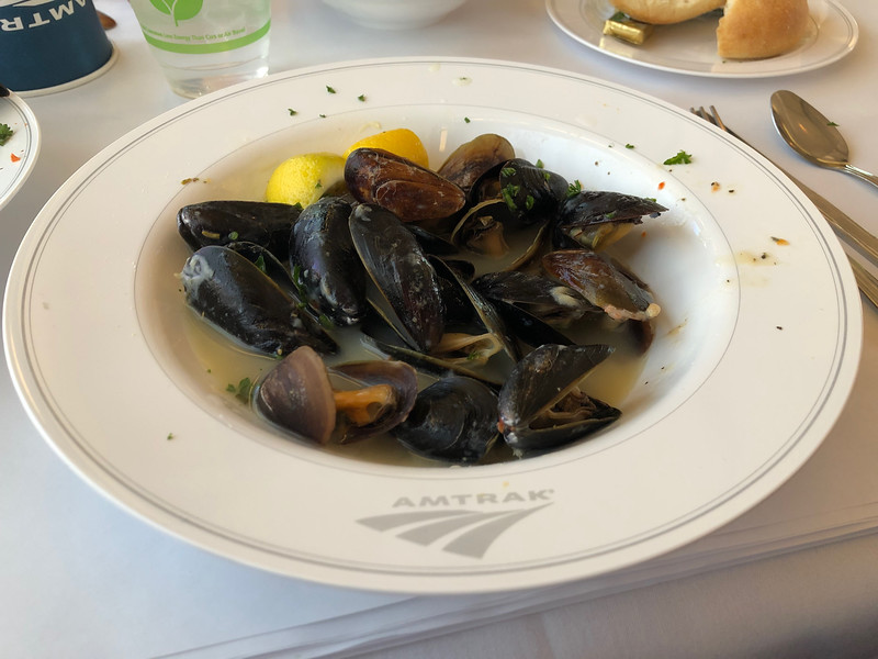 Mussels served in an Amtrak bowl.