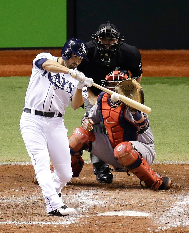 . Tampa Bay Rays\' David DeJesus hits a single to drive in a run in front of Boston Red Sox catcher Jarrod Saltalamacchia in the sixth inning of Game 4 of baseball\'s American League division series, Tuesday, Oct. 8, 2013, in St. Petersburg, Fla. (AP Photo/John Raoux)