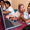 Volunteer assists a nursing student in the computer lab.