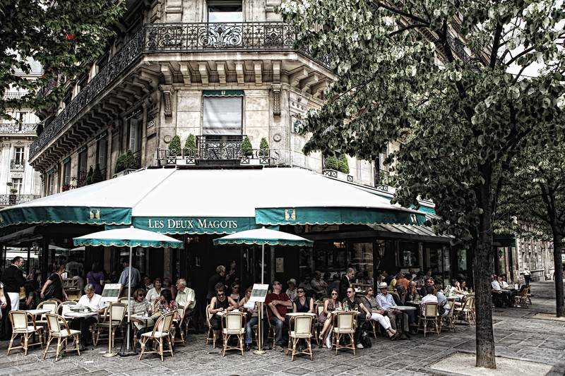 Cafe Les Deux Magots - This famous cafe on the Left Bank of the Seine, Les Deux Magots is popular with both tourists and Parisians, It has a long history as a meeting place for famous writers and philosophers. Deux Magots was once a favorite spot for existentialist writers Jean-Paul Sartre and Simone de Bouvoir, and a favorite of Hemmingway and Picasso where he reportedly created cubism - As a footnote from my own personal experience, while I like Les Deux Magots, a couple of 'surly waiter' experiences (not the norm, but they happened) sent me try Cafe de Flore just a block down the street to the left, and I found it to be a better, friendlier dining experience and equal in its storied history. I'd give it a try when you have a chance. - JohnBrody.blogspot..com  / JohnBrody.com / John Brody Photography