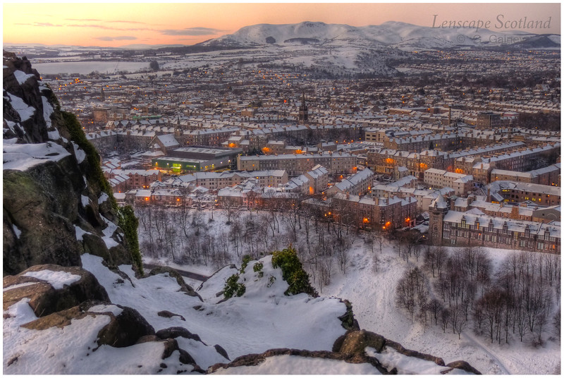 Edinburgh under snow, as seen from Salisbury Crags at dawn
