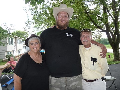 On the left, my 69 year old first cousin Donna. In the middle, my 30 year old first cousin once removed Mick. I'm the little guy (6 feet tall) on the right. Mick weighs about 450 pounds. I weigh about 168.