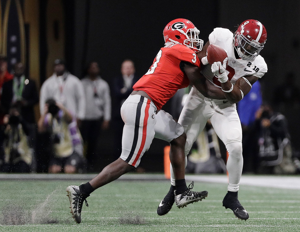 . Alabama\'s Bo Scarbrough catches a pass in front of Georgia\'s Roquan Smiths during the second half of the NCAA college football playoff championship game Monday, Jan. 8, 2018, in Atlanta. (AP Photo/David J. Phillip)