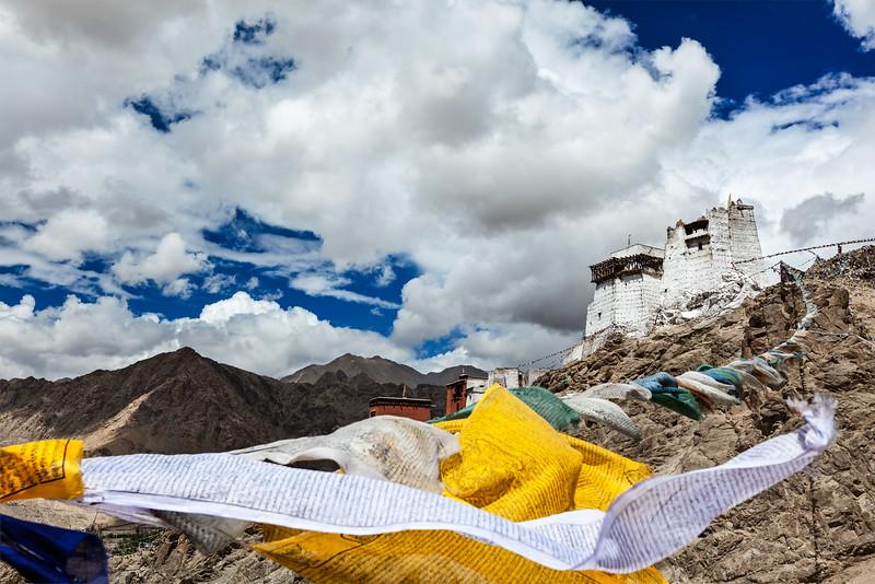 Leh gompa and lungta (prayer flags). Leh, Ladakh, India