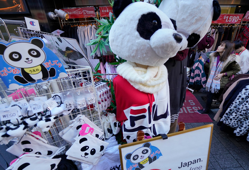 . In this Sunday, Dec. 17, 2017, photo, panda goods are displayed for sale at an open-air market at Ameyoko shopping district near Ueno Zoo in Tokyo. Xiang Xiang, which means fragrance in Chinese, was born in June at Tokyo�s Ueno Zoo to its resident panda. It�s a first one in 39 years to have been born in Ueno, known as a panda town. The zoo and its neighborhood celebrated Xiang Xiang�s healthy growth especially after the death of a days-old baby panda five years ago.(AP Photo/Shizuo Kambayashi)