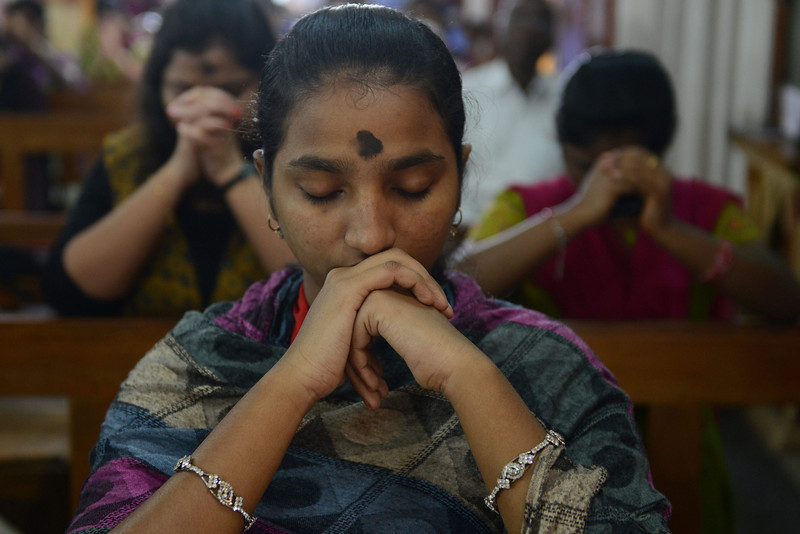 . Indian Catholic devotees offer prayers during an Ash Wednesday service at Saint Mary\'s Basilica in Secunderabad, the twin city of Hyderabad, on March 5, 2014. Catholic Christians are observing Ash Wednesday which marks the official beginning of the 40-day period of Lenten season which culminates in Holy Week. (NOAH SEELAM/AFP/Getty Images)