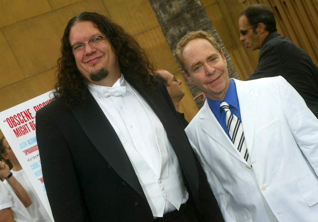 ". LOS ANGELES, CA - JULY 20: Comedians Penn Jillette (L) and Teller arrive at the Los Angeles premiere of the ""The Aristocrats\"" at The Egyptian Theatre on July 20, 2005 in Hollywood, California. (Photo by Matthew Simmons/Getty Images)"