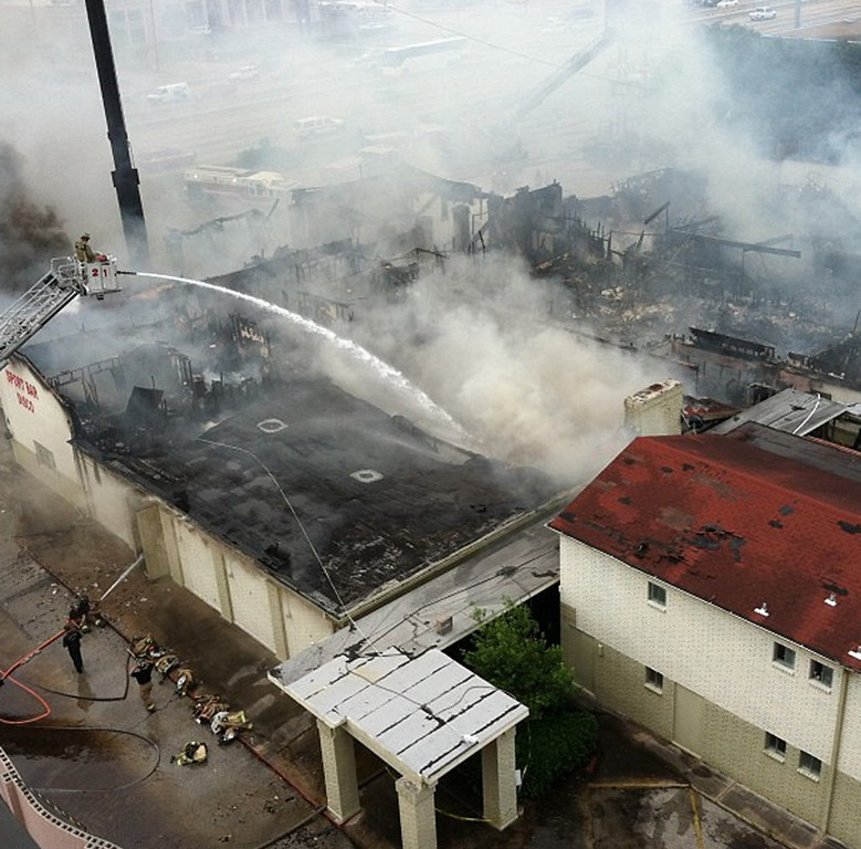 . Firefighters battle a blaze at the Southwest Inn, Friday, May 31, 2013, in Houston. Four firefighters have died and at least five people have been hospitalized. (AP Photo/KTRK-TV, Kevin Quinn)