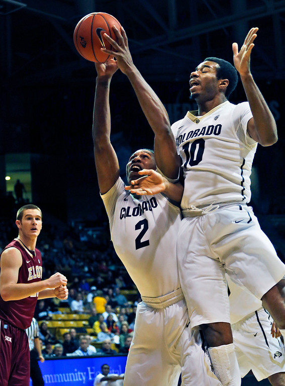 . Colorado\'s Xavier Johnson (2) and Tre\'Shaun Fletcher (10) collide while going up to grab a rebound during an NCAA college basketball game against Elon in Boulder, Colo., Friday, Dec. 13, 2013. (AP Photo/Brennan Linsley)