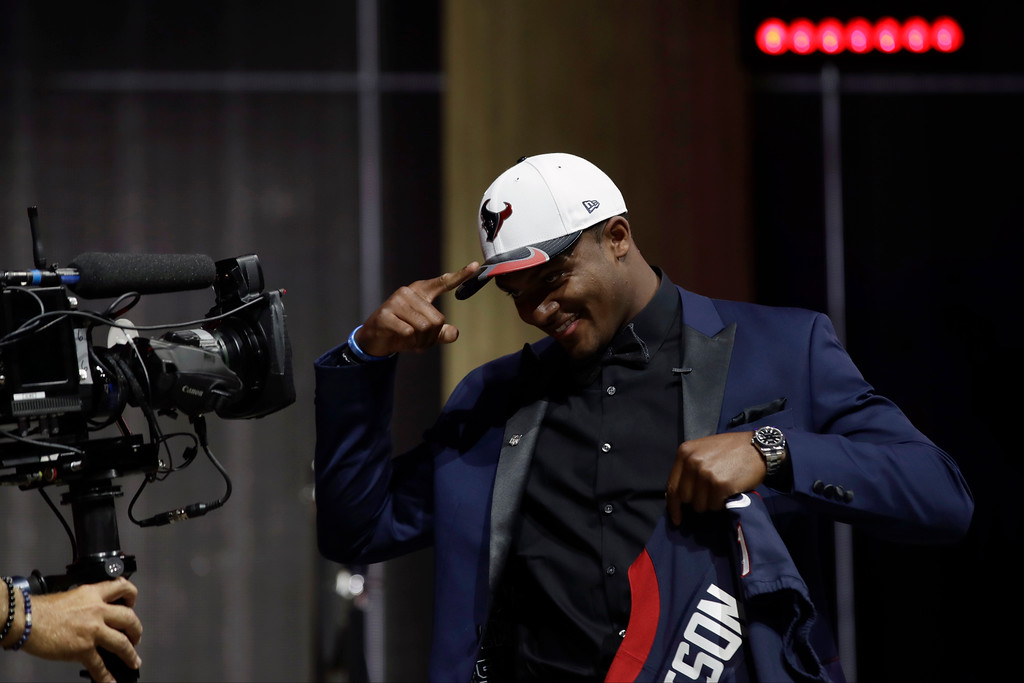 . Clemson\'s Deshaun Watson gestures to a camera after being selected by the Houston Texans during the first round of the 2017 NFL football draft, Thursday, April 27, 2017, in Philadelphia. (AP Photo/Matt Rourke)