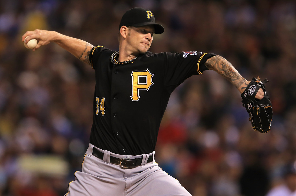 . DENVER, CO - AUGUST 10:  Starting pitcher A.J. Burnett #34 of the Pittsburgh Pirates delivers against the Colorado Rockies at Coors Field on August 10, 2013 in Denver, Colorado.  (Photo by Doug Pensinger/Getty Images)