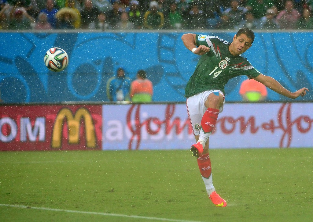 . Mexico\'s forward Javier Hernandez kicks the ball during the Group A football match between Mexico and Cameroon at the Dunas Arena in Natal during the 2014 FIFA World Cup on June 13, 2014.  AFP PHOTO / YURI  CORTEZ/AFP/Getty Images