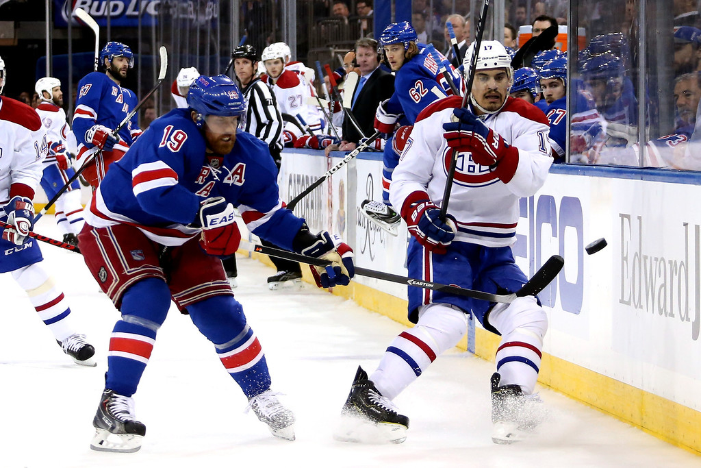 . Rene Bourque #17 of the Montreal Canadiens and Brad Richards #19 of the New York Rangers battle for the puck during Game Six of the Eastern Conference Final in the 2014 NHL Stanley Cup Playoffs at Madison Square Garden on May 29, 2014 in New York City.  (Photo by Bruce Bennett/Getty Images)