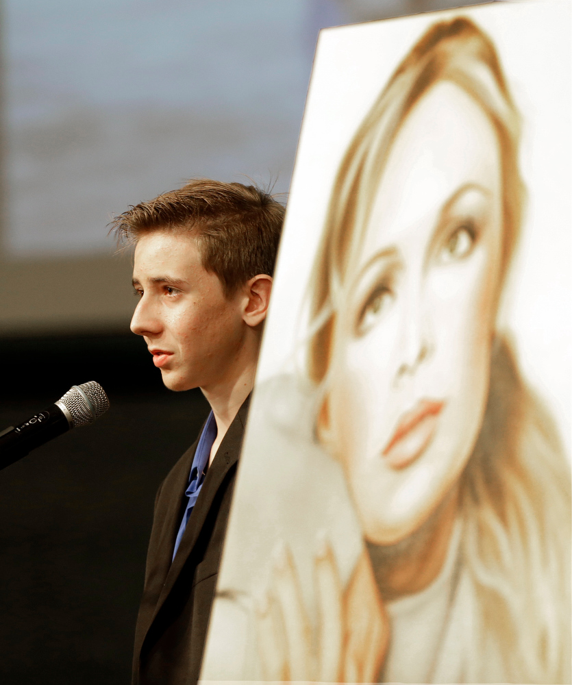 . Skylar Phelan younger brother of country music star Mindy McCready, recalls the life of hof his sister during the funeral ceremony at the Crossroads Baptist Church in Fort Myers, Fla.,Tuesday, Feb. 26, 2013. McCready committed suicide Feb. 17 at her home in Arkansas, days after leaving a court-ordered substance abuse program. (AP Photo/Alan Diaz)