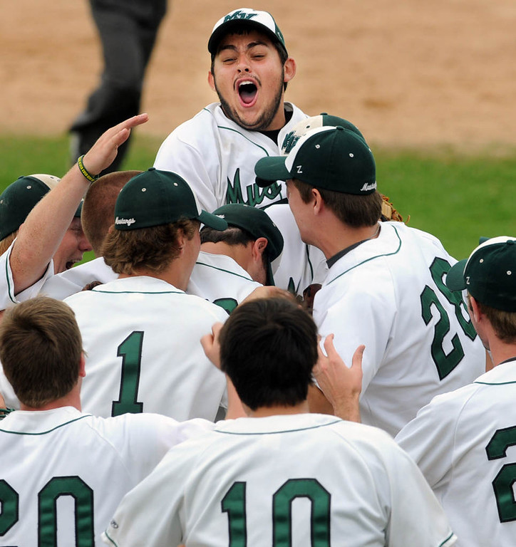 . Mounds View first baseman Keith Kubitschek, top, joins his teammates in celebrating their 9-4 win over Coon Rapids in a Class 3A baseball semifinal game at Midway Stadium in St. Paul, Friday, June 14, 2013. (Pioneer Press: Chris Polydoroff)