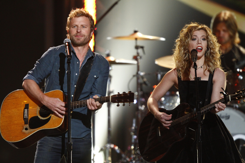 Description of . Dierks Bentley, left,  and Kimberly Perry, of the musical group The Band Perry, perform at the Grammy Nominations Concert Live! at Bridgestone Arena on Wednesday, Dec. 5, 2012, in Nashville, Tenn. (Photo by Wade Payne/Invision/AP)