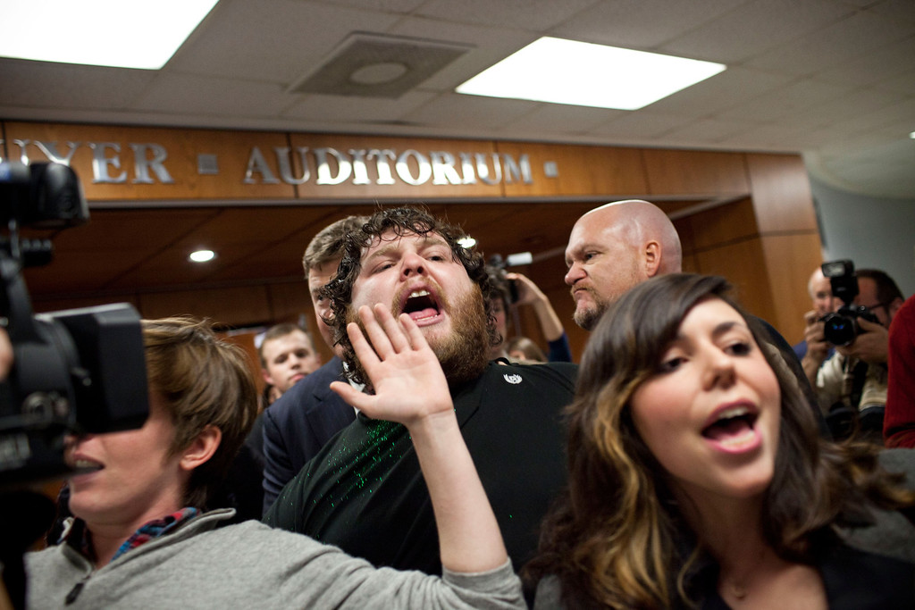 . CHARLESTON, SC - JANUARY 21:  Protesters affiliated with the Occupy Wall Street movement are forcibly removed from a primary night event held by Republican presidential candidate, former U.S. Sen. Rick Santorum after protesting Santorum\'s stance on gay-rights at the end of the rally, on January 21, 2012 in Mark Clark Hall at the Citadel in Charleston, South Carolina.  Former Speaker of the House Newt Gingrich took first place in the South Carolina Primary, with Santorum placing third.  (Photo by Andrew Burton/Getty Images)