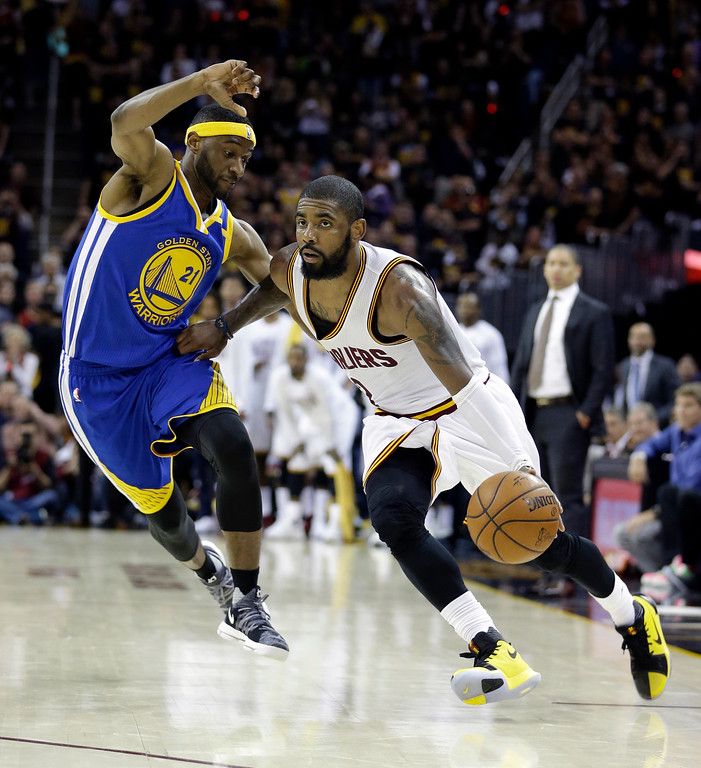 . Cleveland Cavaliers guard Kyrie Irving (2) drives on Golden State Warriors guard Ian Clark (21) during the second half of Game 3 of basketball\'s NBA Finals in Cleveland, Wednesday, June 7, 2017. (AP Photo/Tony Dejak)