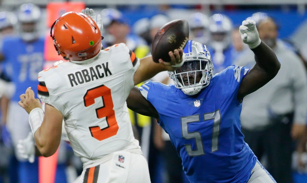 . Detroit Lions defensive end Cam Johnson (57) rushes Cleveland Browns quarterback Brogan Roback (3) during the second half of an NFL football preseason game, Thursday, Aug. 30, 2018, in Detroit. (AP Photo/Duane Burleson)
