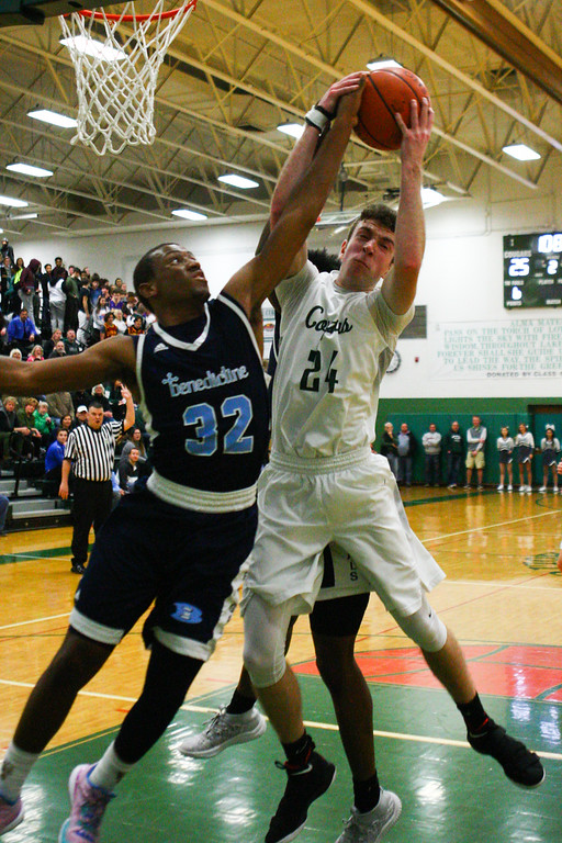 . 2018 - Basketball - Benedictine at Lake Catholic.  Benedictine defeated Lake Catholic 63-56.  Lake Catholic\'s Jack LeJuene (24) fights for a rebound against Benedictine\'s Chris Jefferson (32).