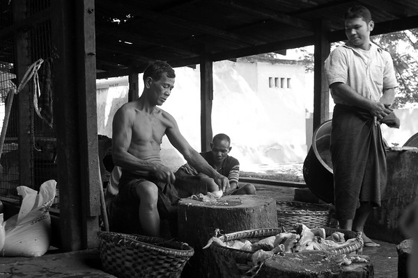 Preparing food for the monks at Maha Ganayon Kyaung monastery, near Mandalay, Myanmar
