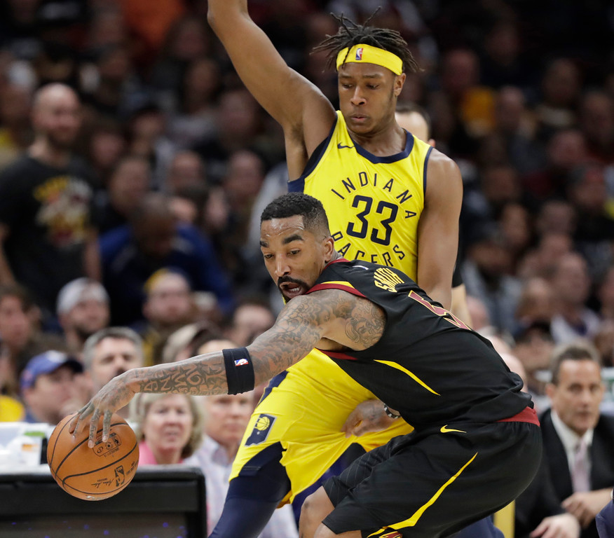 . Cleveland Cavaliers\' JR Smith (5) drives past Indiana Pacers\' Myles Turner (33) in the second half of Game 7 of an NBA basketball first-round playoff series, Sunday, April 29, 2018, in Cleveland. The Cavaliers won 105-101. (AP Photo/Tony Dejak)