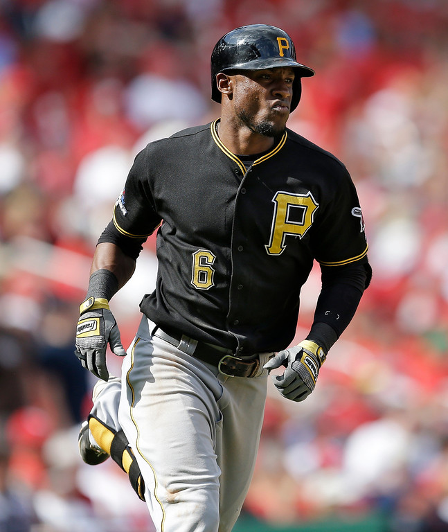 . Pittsburgh Pirates\' Starling Marte rounds the bases after hitting a solo home run against the St. Louis Cardinals in the eighth inning of Game 2 of baseball\'s National League division series on Friday, Oct. 4, 2013, in St. Louis. (AP Photo/Jeff Roberson)