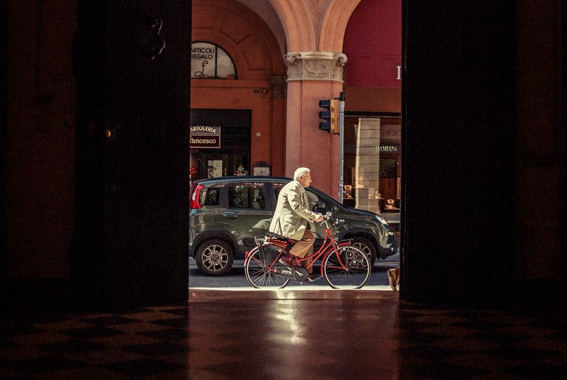 bike rider bologna hallway entrance older man doorway italy.jpg