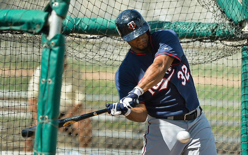 . Twins outfielder Aaron Hicks hacks at a pitch from Alex Meyer. (Pioneer Press: Ben Garvin)