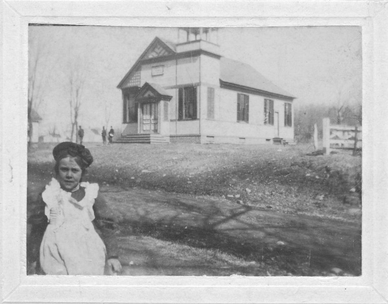 A young Annie Rhymer poses in front of Union's Town Hall building in the late 1800s.